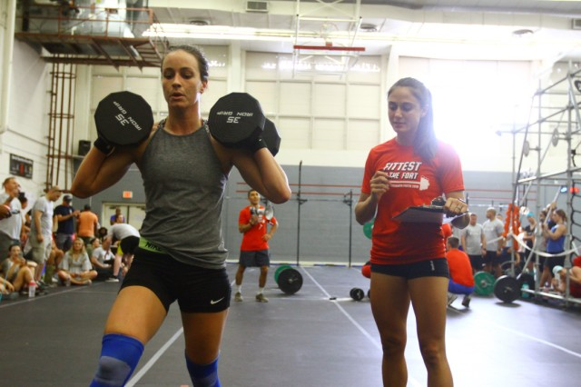 Briana White does lunges while grader Kita Marett monitors her progress.
