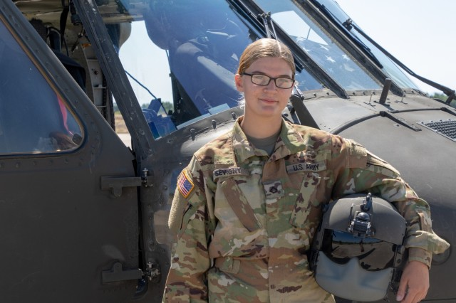 Pfc. Catherine Sevigny stands in front of a UH-60 Black Hawk helicopter after paradrop training in Plovdiv, Bulgaria, August 21st, 2019. Sevigny is part of the 3rd Assault Helicopter Battalion, 1st Aviation Regiment, and works as a crew chief whose primary duty is maintaining Black Hawks. Sevigny participated in the paradrop training, and was able to use the opportunity to become qualified in paradrop operations. (U.S. Army photo by Pfc. Andrew Wash)