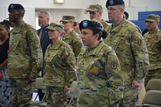 Lt. Col. Maria Bruton (front center) assumes command of the U.S. Army Health Clinic Stuttgart from Lt. Col. Keith Burnette (left) during a change of command ceremony held at Patch Barracks, Stuttgart, Germany, Aug. 21, 2019.