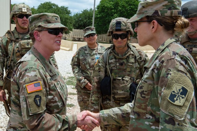 Now Maj. Gen. Tracy Norris, the adjutant general of Texas, visits Soldiers at Camp Bullis, Texas, on June 21, 2018.