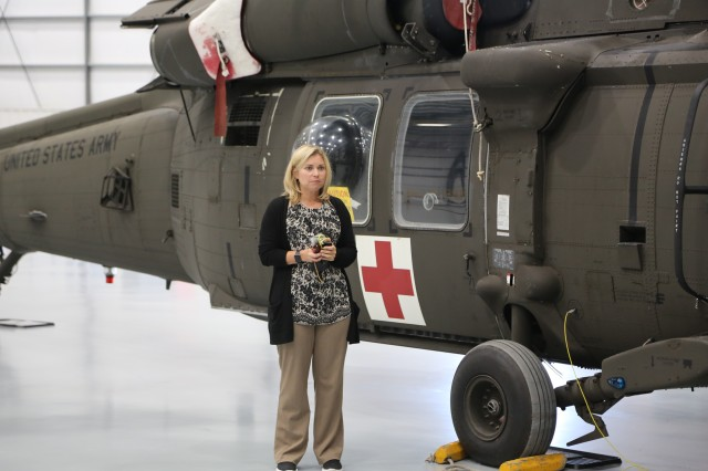 FILE - Miranda Oden, U.S. Army Combat Capabilities Development Command Aviation & Missile Center Engineering Directorate Prototype Integration Facility division chief, explains the PIF's UH-60 work during a tour of the M5 Meridianville Yulista Hangar in Meridianville, Alabama Aug. 23, 2018. An AvMC PIF employee since 2009, Oden last served as a supervisor over the facility's CH-47, UH-60 and Navy ground programs.