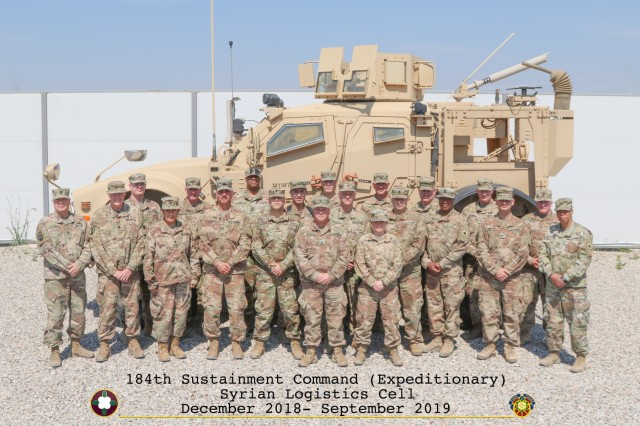 Members of the 1st Theater Sustainment Command's Syrian Logistics Cell stand for a group photo in Erbil, Iraq. (U.S. Army National Guard photo by Staff. Sgt. Veronica McNabb)