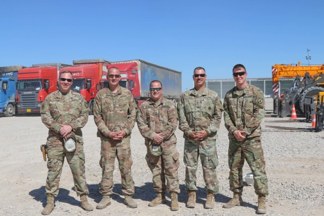 Logistics yard movement team leaders from for the 1st Theater Sustainment Command's Syrian Logistics Cell pose for a photo during a supply upload on April 26, 2019, in Erbil, Iraq. From left to right are: Warrant Officer Kevin Miller, 300th Sustainment Brigade; Sgt. First Class Daniel Lofton, 184th Sustainment Command: Master Sgt. Erick Deitrick, 184th Sustainment Command: Sgt. First Class Jason Craft, 184th Sustainment Command; and 1st Lt. Welton Miller, 300th Sustainment Brigade. (U.S. Army National Guard photo by Staff Sgt. Veronica McNabb)