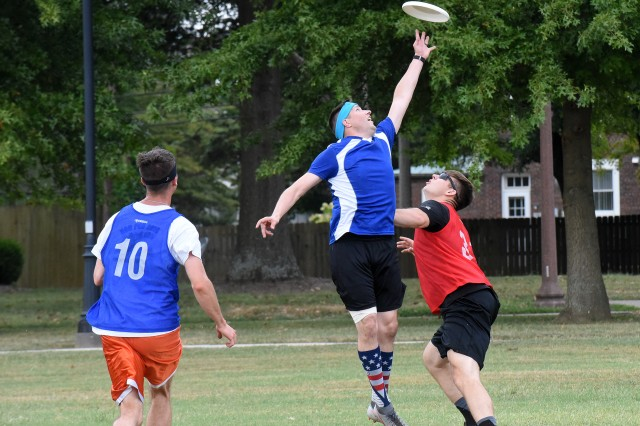 A player from HRC (center) reaches for a Frisbee during their championship game against 19th Engineers Aug. 20, 2019. 19th finished the Ultimate Frisbee tournament on top.