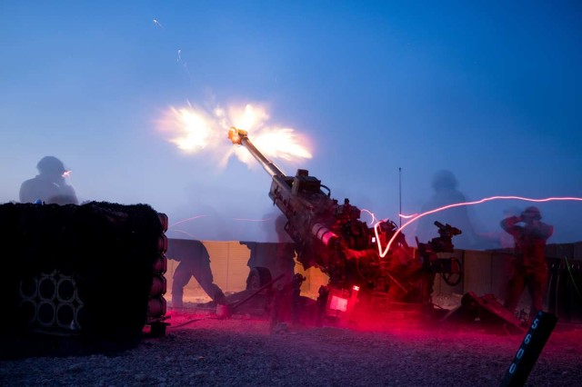 Soldiers fire a M777 towed 155 mm Howitzer on Qayyarah West Airfield, Iraq, Aug. 10, 2019. The Soldiers from 32nd Field Artillery, 1st Brigade Combat Team, 101st Airborne Division, conducted a fire mission to disrupt known enemy positions. As long as Daesh presents a threat, Combined Joint Task Force -- Operation Inherent Resolve remains committed to enabling its defeat.