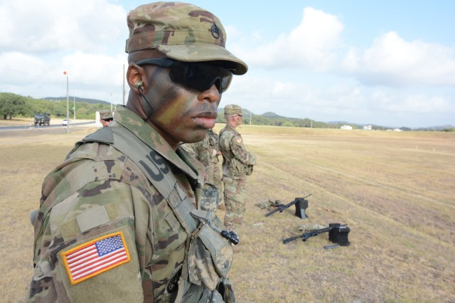U.S. Army Staff Sgt. Earnest J. Knight II, Drill Sergeant Academy, with camouflage face paint at a Camp Bullis shooting range. Knight is the 2019 U.S. Army Drill Sergeant of the Year.
