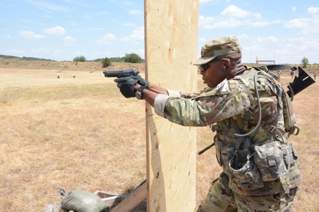 U.S. Army Sgt. Earnest Knight II, Drill Sergeant Academy, firing an M9 at the mystery event. In this lane while firing from the the standing, kneeling, and prone positions the competitors first fired the M4 rifle then transitioned to the M4 pistol. Knight is the 2019 U.S. Army Drill Sergeant of the Year.
