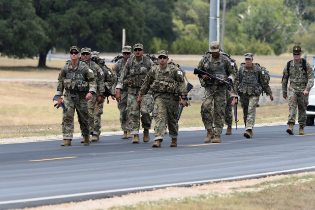 The 2019 Drill Sergeant of the Year nominees on a ruck march to a Camp Bullis shooting range.