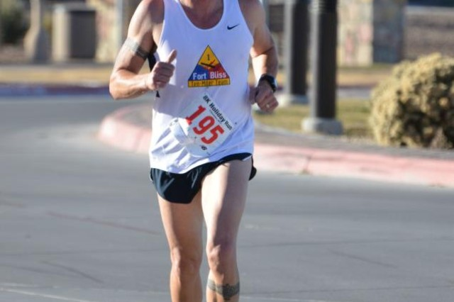 Brandon Gangstad, the operations chief for the Directorate of Plans, Training, Mobilization and Security for the garrison at Fort Bliss, Texas and civilian employee of the Department of the Army, races during a holiday run at Fort Bliss, Texas. Gangstad has coached the Fort Bliss Army Ten Miler Team since 2007, promoting the importance of teamwork and commitment throughout his tenure.