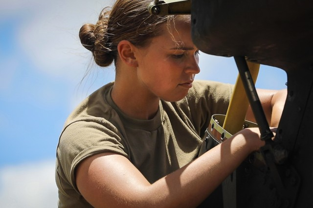 U.S. Army Pfc. Tess Sandoval assigned to 2nd Squadron, 6th Calvary Regiment, 25th Combat Aviation Brigade is one of two female attack helicopter repairers in the squadron located on Wheeler Army Airfield, Hawaii, Aug. 25, 2019. Women make up about six percent of all attack helicopter repairers in the U.S. Army.