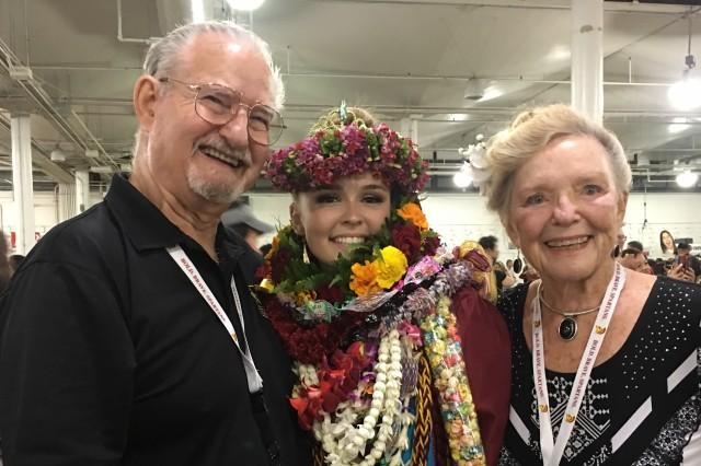 U.S. Army Col. (Ret.) Kenn Sprague (left) with Pfc. Tess Sandoval and grandmother Margo Sprague at Sandoval's high school graduation, May 2018.