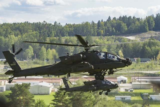 Army AH-64 Apache Attack Helicopters belonging to the 1st Squadron, 6th Cavalry Regiment, 1st Combat Aviation Brigade, 1st Infantry Division, hover in formation prior to a simulated mission as part of Combined Resolve XII on a range at Hohenfels Training Area, Germany, Aug. 16, 2019. Combined Resolve is a biannual U.S. Army Europe and 7th Army Training Command-led exercise intended to evaluate and certify the readiness and interoperability of US forces mobilized to Europe in support of Atlantic Resolve. (U.S. Army photo by Sgt. Jeremiah Woods)