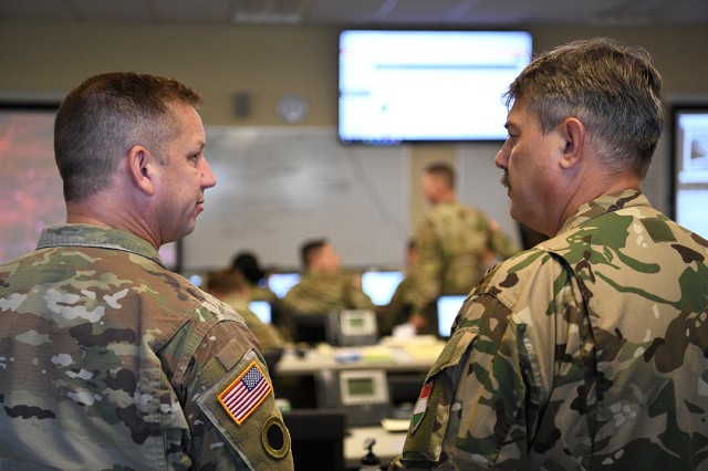 Maj. Daniel Mueller (left), chief of operations for the Vigilant Guard 19-4 Joint Task Force, explains the disaster response exercise to Brig. Gen. Laszlo Garas, director of joint operations for the Hungarian Defence Forces, Aug. 5, 2019, in Springfield, Ohio. Vigilant Guard provides civil-military first responders and emergency management personnel the opportunity to evaluate their capabilities to react to an actual man-made or natural disaster. Ohio has been paired with Hungary through the State Partnership Program since 1993.