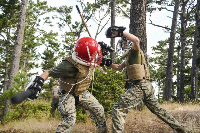 Marines practice weapons of opportunity training during the culminating event of the Marine Corps Martial Arts Instructor course Aug. 9 at the Presidio of Monterey.