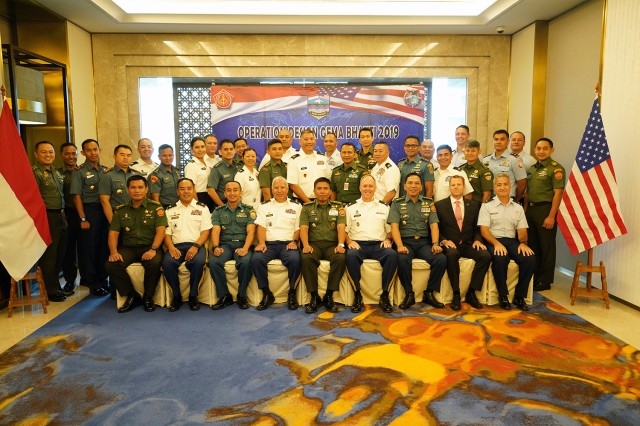 Hawaii National Guard Soldiers and Airmen pose for the group photo along with their Tentara Nasional Indonesia counterparts, Jakarta, Indonesia, August 19, 2019. Hawaii National Guard is State Partners with Indonesia and regularly holds combined exercises and events to increase the depth of that relationship. This is the second year the Hawaii and Indonesia have participated in an operation design seminar. operation design is a process where a committee of military members and sometimes members of government examine very complex problems to help define variables, goals, tension points and desired end state to aid in the planning and execution of military or governmental action.