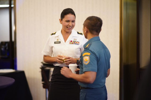 Maj. Tulsi Gabbard, Hawaii Army National Guard military police officer, reviews the operation design process with a Tentara Nasional Indonesia officer during a group break out, Jakarta, Indonesia, August 19, 2019. Hawaii National Guard is State Partners with Indonesia and regularly holds combined exercises and events to increase the depth of that relationship. This is the second year the Hawaii and Indonesia have participated in an operation design seminar. operation design is a process where a committee of military members and sometimes members of government examine very complex problems to help define variables, goals, tension points and desired end state to aid in the planning and execution of military or governmental action.
