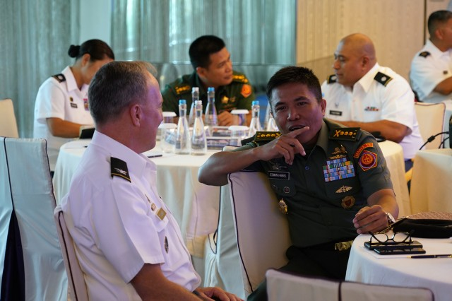 Col. Micheal Tougher, Hawaii Army National Guard Commander and Col. Edwin Habel, Tentara Nasional Indonesia commander, discuss the goal of the operation design seminar and what each other hope to gain in participating in the event, Jakarta, Indonesia, August 19, 2019. Hawaii National Guard is State Partners with Indonesia and regularly holds combined exercises and events to increase the depth of that relationship. This is the second year the Hawaii and Indonesia have participated in an operation design seminar. operation design is a process where a committee of military members and sometimes members of government examine very complex problems to help define variables, goals, tension points and desired end state to aid in the planning and execution of military or governmental action.
