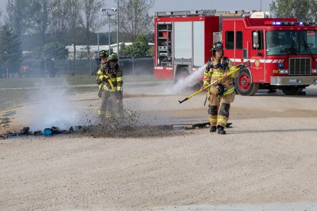 Military firefighters from the 524th Engineer Detachment put out a fire during an emergency response exercise on Mihail Kogalniceanu Air Base August 22, 2019. The goal of the ERE was to conduct a safe and successful exercise, which challenges and prepares base personnel to prepare and manage a mass casualty causing event, whether it be a natural disaster, accident, terrorist or insider threat situation. Exercises like this also allow Army Support Activity Black Sea and MK AB garrison staff to develop reaction and contingency plans for real world situations regarding base emergencies.