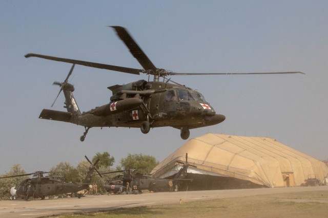A UH-60 Black Hawk helicopter from 1st Combat Aviation Brigade, 1st Infantry Division, takes off during an emergency response exercise on Mihail Kogalniceanu Air Base August 22, 2019. The goal of the ERE was to conduct a safe and successful exercise, which challenges and prepares base personnel to prepare and manage a mass casualty causing event, whether it be a natural disaster, accident, terrorist or insider threat situation. Exercises like this also allow Army Support Activity Black Sea and MK AB garrison staff to develop reaction and contingency plans for real world situations regarding base emergencies.