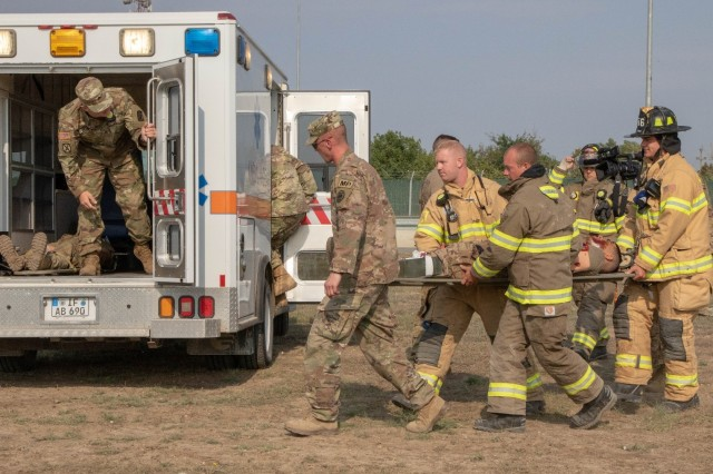 Soldiers load a simulated casualty onto an ambulance during an emergency response exercise on Mihail Kogalniceanu Air Base August 22, 2019. The goal of the ERE was to conduct a safe and successful exercise, which challenges and prepares base personnel to prepare and manage a mass casualty causing event, whether it be a natural disaster, accident, terrorist or insider threat situation. Exercises like this also allow Army Support Activity Black Sea and MK AB garrison staff to develop reaction and contingency plans for real world situations regarding base emergencies.