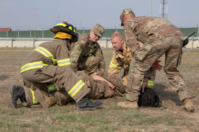 Army first responders provide care to a simulated casualty during an emergency response exercise on Mihail Kogalniceanu Air Base August 22, 2019. The goal of the ERE was to conduct a safe and successful exercise, which challenges and prepares base personnel to prepare and manage a mass casualty causing event, whether it be a natural disaster, accident, terrorist or insider threat situation. Exercises like this also allow Army Support Activity Black Sea and MK AB garrison staff to develop reaction and contingency plans for real world situations regarding base emergencies.