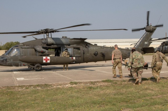 Soldiers load a simulated casualty onto a UH-60 Black Hawk helicopter during an emergency response exercise on Mihail Kogalniceanu Air Base August 22, 2019. The goal of the ERE was to conduct a safe and successful exercise, which challenges and prepares base personnel to prepare and manage a mass casualty causing event, whether it be a natural disaster, accident, terrorist or insider threat situation. Exercises like this also allow Army Support Activity Black Sea and MK AB garrison staff to develop reaction and contingency plans for real world situations regarding base emergencies.