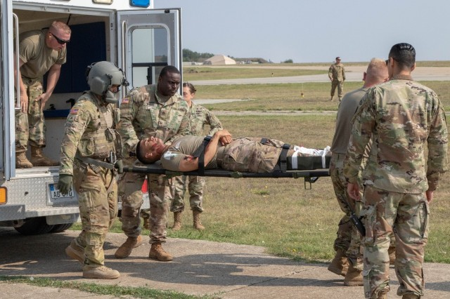 Soldiers off load simulated casualty from an ambulance to load onto a UH-60 Black Hawk helicopter during an emergency response exercise on Mihail Kogalniceanu Air Base August 22, 2019. The goal of the ERE was to conduct a safe and successful exercise, which challenges and prepares base personnel to prepare and manage a mass casualty causing event, whether it be a natural disaster, accident, terrorist or insider threat situation. Exercises like this also allow Army Support Activity Black Sea and MK AB garrison staff to develop reaction and contingency plans for real world situations regarding base emergencies.
