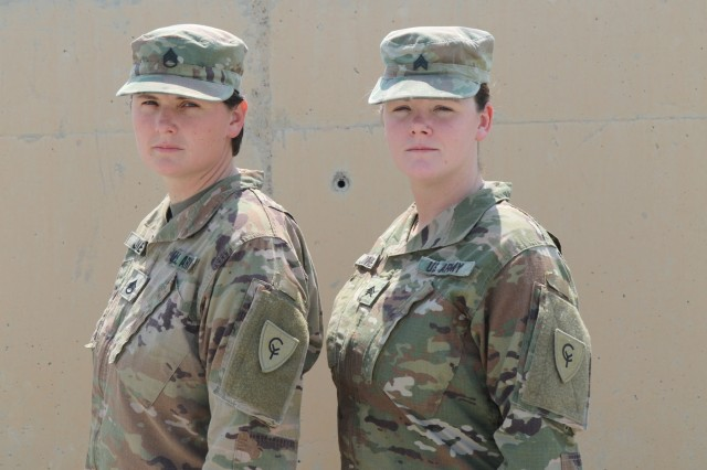 Staff Sgt. Justine Jones, a culinary specialist from Gary, Indiana proudly stands with her sister, Sgt. Jenna Jones, aviation operations specialist from Gary, Indiana, Wednesday, August 21, 2019. The sisters support Task Force Spartan building lasting and trusting relationships with regional partners from Camp Arifjan, Kuwait.