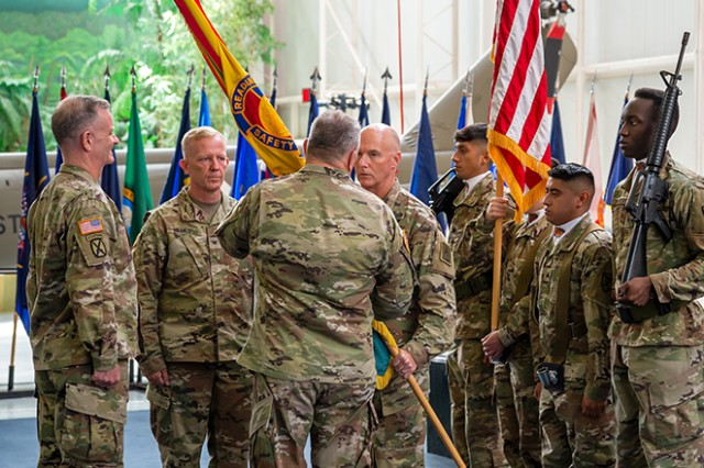 Brig. Gen. Timothy J. Daugherty (right center), outgoing commander, receives the colors from Command Sgt. Maj. William L. Gardner (right), as Lt. Gen. Walter E. Piatt (left), director of Army staff, and incoming commander Col. Andrew C. Hilmes (left center) await the colors during a change of command ceremony. Brig. Gen. Daugherty officially relinquished command of the U.S. Army Combat Readiness Center to Col. Hilmes at the United States Army Aviation Museum, Fort Rucker, Alabama, Aug. 22, 2019.