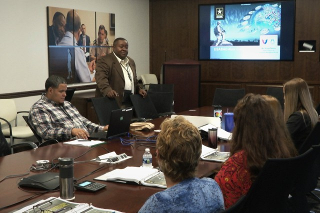 Ricky Tanna, the deputy CIO/G6 at USASAC New Cumberland, talks with the new employees about his department and the expectations for the new hires.