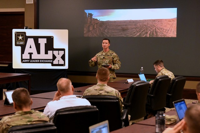 "Army Maj. Josh Powers, founder of the ""Field Grade Leader"" blog, talks about ""Self Development Through Extended Influence,"" during the Army Leader Exchange program Aug. 15, 2019 in the Lewis and Clark Center's Arnold Conference Room, Fort Leavenworth, Kan. Powers talked about the use of digital tools, including social media, to help officers connect and interact with each other to enhance their own learning as well as help their peers.  Powers' blog is focused on organizational leadership in the military. Hosted by the Center for Army Leadership, ALx is a series of talks on leadership and leader development from national and local military and civilians. Photo by Tisha Swart-Entwistle, Combined Arms Center Public Affairs Office."