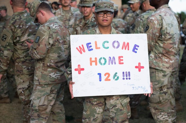 Soldiers and leaders from 1st Medical Brigade greet the 126th Forward Resuscitative Surgical Team as they return from a nine month deployment in Syria Aug. 23.   The 126th was the first fully equipped and staffed FRST to deploy in any theater of war and their mission was crucial to the warfighters in the region (U.S. Army photo by Sgt. 1st Class Kelvin Ringold)