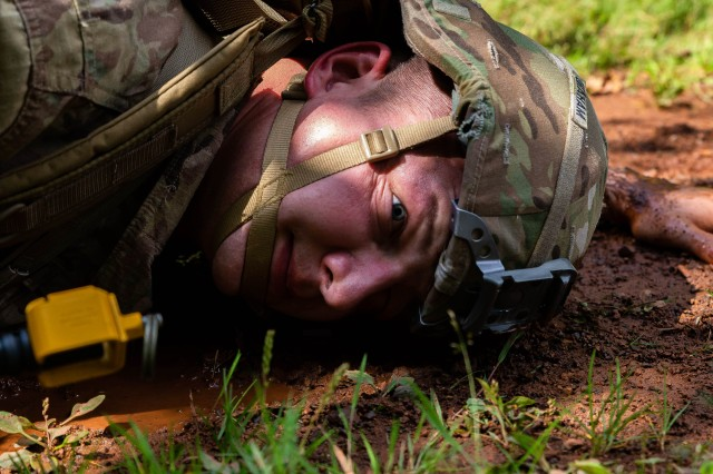 Staff Sgt. Michael Graham, a combat medic assigned to U.S. Army Medical Department Activity Bavaria headquarters, crawls through the dirt during one of the events in the Regional Health Command Europe Best Medic competition.