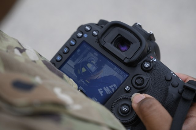 U.S. Army Reserve Spc. Nicole Baker, a broadcast specialist with 301st Public Affairs Detachment in Mesa, Arizona, checks her photos while learning basic operations during 46 Sierra conversion training, Fort McCoy, Wisconsin, Aug. 12, 2019. Soldiers trained with the new cameras in order to familiarize themselves with the standard kit. (U.S. Army Reserve photo by Spc. Maximilian Huth)