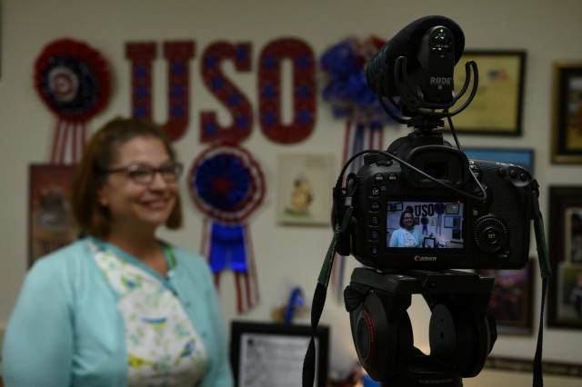 U.S. Army Reserve Spc. Clevon Wright, a public affairs specialist with the 367th Public Affairs Detachment in Whitehall, Ohio, interviews Ellie Hazlett, director of operations for USO Wisconsin, to continue to practice his broadcasting skills at the Fort McCoy USO, Wisconsin, Aug. 15, 2019. Soldiers learned to conduct video interviews with elements like audio and video composition. (U.S. Army Reserve photo by Spc. Maximilian Huth)