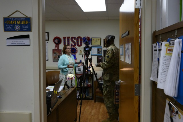 U.S. Army Reserve Spc. Clevon Wright,  a public affairs specialist with 367th Public Affairs Detachment in Whitehall, Ohio, interviews Ellie Hazlett, director of operations for USO Wisconsin, as part of an extra mission from the conversion course, Fort McCoy USO, Wisconsin, Aug. 15, 2019. Once validated, Soldiers took on extra missions in order to hone their newly learned skills. (U.S. Army Reserve photo by Spc. Maximilian Huth)