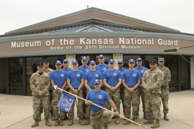 Warrant Officer Candidate School Class 19-001 pose for a picture after completing their community outreach project at the Museum of the Kansas National Guard in Topeka, Kansas, Aug. 24, 2019. WOCs prepared a new exhibit at the museum and assisted Master Sgt. Jeremy Byers, the command state historian of the Kansas Army National Guard, in inventorying the museum's extensive weapons collection.