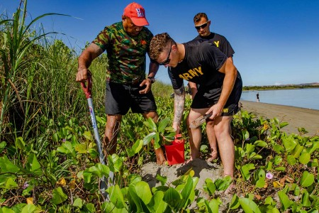 Fijian Army sergeant with the Fiji Infantry Regiment, plants dilo trees with U.S. Army Soldiers from the 25th Infanry Division, during a coastal and reef revitalization project during Exercise Cartwheel 2019, near Nadi, Fiji, Aug. 13, 2019. Part of both the Republic of Fiji Military Forces and the U.S. Indo-Pacific Command's defense strategy is to addresses climate change. The planting of palms, dilo trees and mangroves was an effort to strengthen the coastline with root systems that prevents local silt from pummeling the nearby barrier reef. Opportunities, such as Exercise Cartwheel, provide a platform to deepen understanding and preparedness, which strenthens and enhances key relationships with partner nations for a free and open Indo-Pacific.