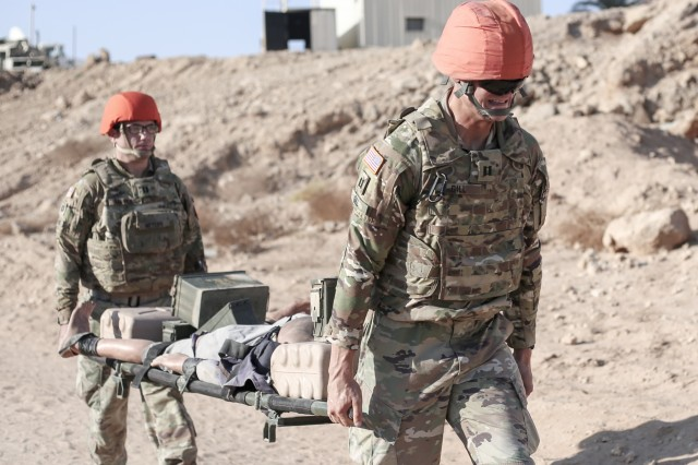 Capt. Christopher Gill and Capt. Hunter Myers, Headquaters, Task Force Sinai, carry a litter during the Best in the Desert competition Aug. 26, 2019, South Camp, Egypt. Hosted by Task Force Sinai, the event brought over 15 teams from three nations together for a morning of skills honing and friendly competition.  Task Force Sinai serves as the U.S. contingent to the Multinational Force & Observers, supporting the MFO's mission to  supervise the implementation of the security provisions of the Egyptian-Israeli Treaty of Peace. (U.S. Army Photo by Capt. Mark Scott)