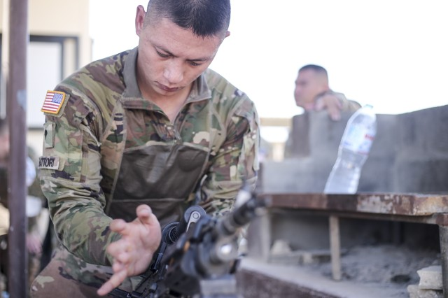 Spc. Derik Hattori,1st Battalion, 294th Infantry Regiment, Guam Army National Guard, assembles an M249 light machine gun during a Best in the Desert competition Aug. 26, 2019, South Camp, Egypt. The competition, hosted by Task Force Sinai, brought over 15 teams from three nations together for a morning of skills honing and friendly competition.  The 1-249 Infantry is serving in Task Force Sinai as U.S. Battalion 66, Multinational Force & Observers, supporting the MFO's mission to  supervise the implementation of the security provisions of the Egyptian-Israeli Treaty of Peace. (U.S. Army Photo by Capt. Mark Scott)