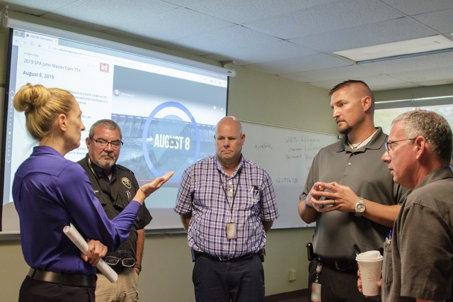 Shelley Dragomir, dam safety program manager (left), and Jeff Daniels, chief, Readiness and Contingency Operations (right), both from USACE-Albuquerque District, discuss future coordination efforts with stakeholders during the exercise at Lamar Community College Aug. 15, 2019. Stakeholders (l-r): Rex Beemer, emergency manager, Kansas; Ralph Goodnight, emergency manager, Kansas and Jerrad Webb, emergency manager, Kansas.