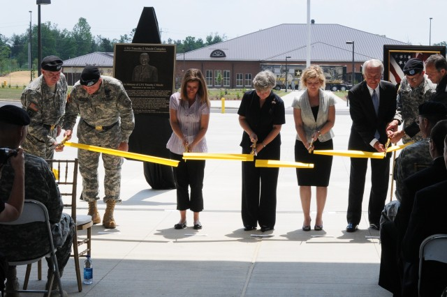 Leaders from U.S. Army Human Resources Command cut the ribbon on the newly constructed Lt. Gen. Timothy J. Maude building May 27, 2010. The ribbon cutters at the ceremony included (from left) Maj. Gen. Sean Byrne, Lt. Gen. Benjamin Freakley, Kathleen Koehler, Teri Maude, Karen Maude, Gov. Steve Beshear, Maj. Gen. John Peabody and Rich Homan.