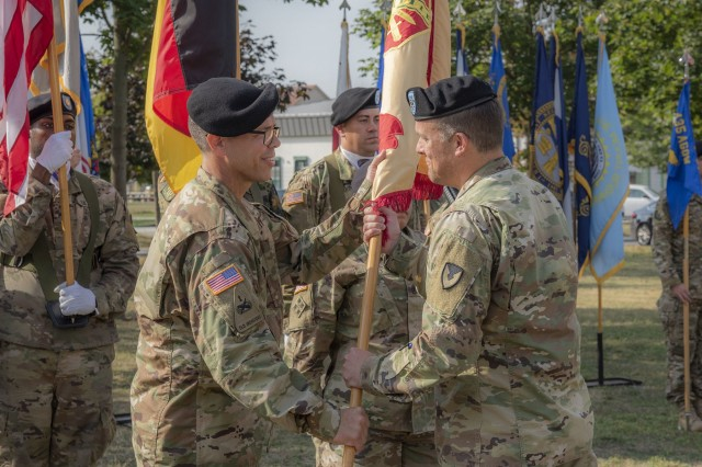 Command Sgt. Maj. Christopher D. Truchon accepts the U.S. Army Garrison Wiesbaden colors from Garrison Commander Col. Noah Cloud Aug. 28, 2019, at USAG Wiesbaden's Clay Kaserne signifying his official assumption of responsibility as the garrison's new command sergeant major. (U.S. Army photo by Volker Ramspott)