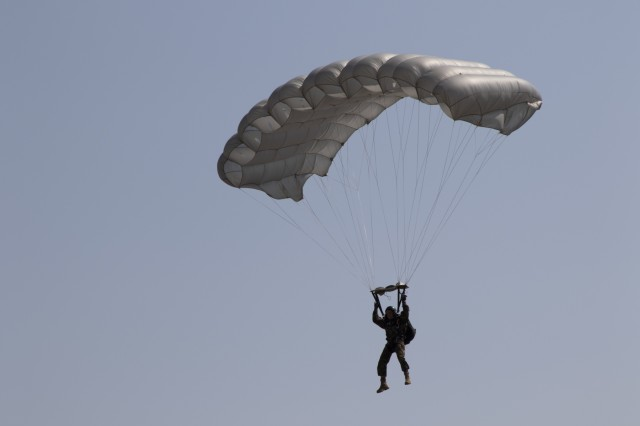 A member of the Bulgarian Special Forces conducts a free-fall paradrop August 22, 2019, in Plovdiv, Bulgaria. Members of the 3rd Assault Helicopter Battalion, 1st Aviation Regiment, facilitated the exercise and flew the UH-60 Black Hawk helicopters that were used during the jumps. (U.S. Army photo by Pvt. Michael Ybarra)