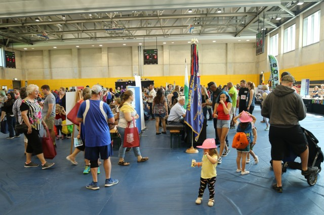Soldiers and their families learn about the many resources available to them at the 2019 U.S. Army Garrison Ansbach, Sportin' The Home Team Community Showcase, August 24, 2019, Katterbach, Germany. The Community Showcase is an annual Morale, Welfare, and Recreation (MWR) sponsored event designed to inform the Soldiers and their families about local services.
