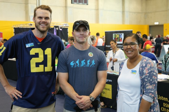 Left to Right, Ryan Moran, Richard Fry, and Toni Mcintyre, Event Coordinators for the 2019 U.S. Army Garrison Ansbach, Sportin' The Home Team Community Showcase, pose for a photo in memory of the hard work they have done to make this event happen, August 24, 2019, Katterbach, Germany. Event coordinations kicked off in January of 2019.