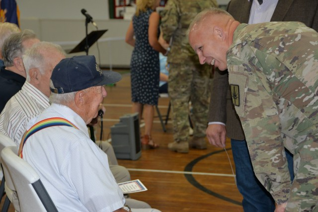 Major General Ray Shields, the Adjutant General of New York, speaks with World War II Navy veteran Edward Taylor, a Hoosick Falls, N.Y. resident prior to an awards ceremony at the former New York State Armory in Hoosick Falls, N.Y. on Wednesday, August 28, 2019. Shields honored local 10 veterans with New York state awards recognizing their military service during the event.