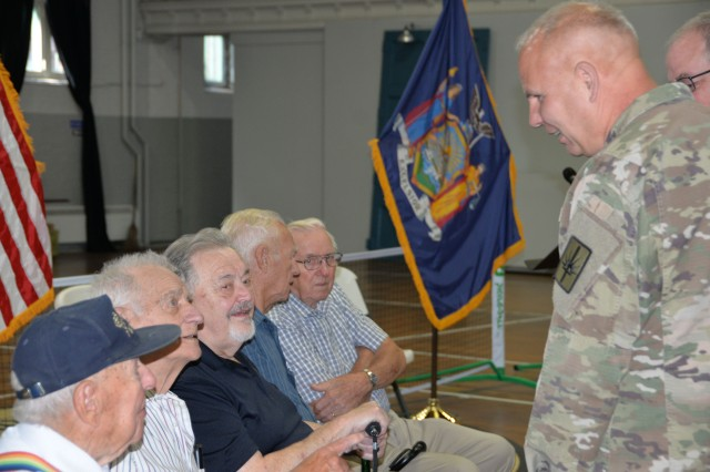 Major General Ray Shields, the Adjutant General of New York, speaks with local veterans prior to an awards ceremony at the former New York State Armory in Hoosick Falls, N.Y. on Wednesday, August 28, 2019. Shields honored 10 local veterans with New York state awards recognizing their military service during the event.