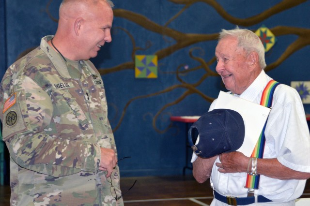 Major General Ray Shields, the Adjutant General of New York, presents the New York State Medal for Merit to Army veteran Charles Krawcyk, who served in Afghanistan and Kuwait with the Vermont Army National Guard, during an awards ceremony at the former New York State Armory in Hoosick Falls, N.Y. on Wednesday, August 28, 2019. Shields honored ten local veterans with New York state awards recognizing their military service during the event.