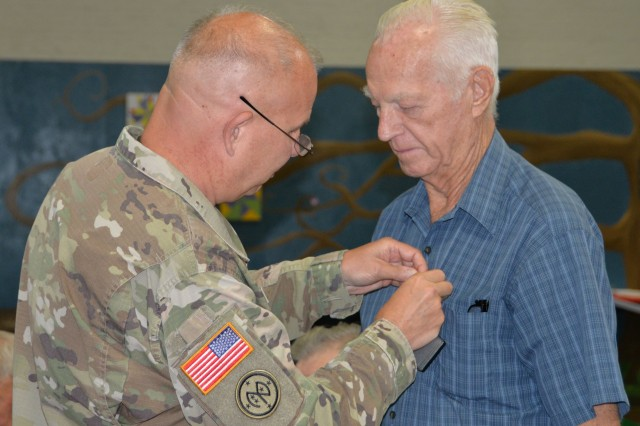 Major General Ray Shields, the Adjutant General of New York, presents the New York State Medal for Merit to Korean War Army veteran Malcolm R. Brownell during an awards ceremony at the former New York State Armory in Hoosick Falls, N.Y. on Wednesday, August 28, 2019. Shields honored ten local veterans with New York state awards recognizing their military service during the event.